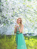 Beautiful cute girl in a spring day. Floral tree Royalty Free Stock Images