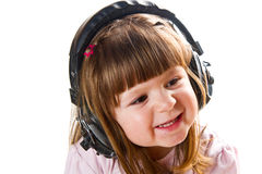 Beautiful cute happy little girl with headphones Royalty Free Stock Photography