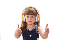 Beautiful cute happy little girl with headphones Stock Photography
