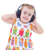 Beautiful cute happy little girl with headphones Royalty Free Stock Images
