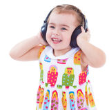 Beautiful cute happy little girl with headphones Stock Photos