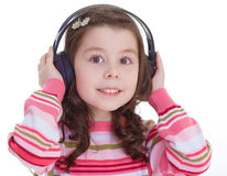Beautiful cute happy little girl with headphones. Royalty Free Stock Images