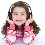 Beautiful cute happy little girl with headphones. Stock Photography