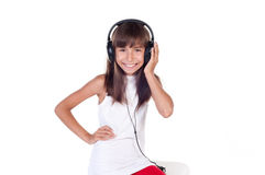 Beautiful cute happy little girl with headphones Stock Photo