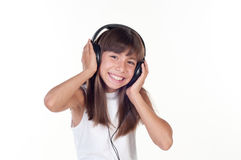 Beautiful cute happy little girl with headphones Royalty Free Stock Photo