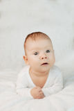 Beautiful cute laughing baby. Boy or girl on white. Little child Stock Photos