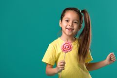 Beautiful cute little girl with a lollipop stock photography