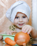 Beautiful cute little cook with vegetables Royalty Free Stock Image
