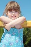 Beautiful cute little girl in blue dress rests hands Stock Photos