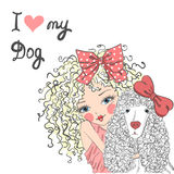 Beautiful cute little girl with a dog poodle. Beautiful cute little girl with a dog poodle on a background with the words I love my dog Stock Photos