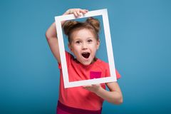 Beautiful Cute Little Girl In Pink Dress Holds Picture Frame Stock Photography