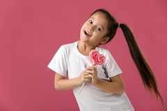 Beautiful cute little girl with a lollipop royalty free stock photography