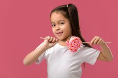 Beautiful cute little girl with a lollipop stock image