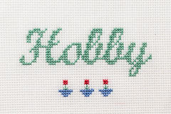 Beautiful cute miniature embroidery word Hobby Stock Photos