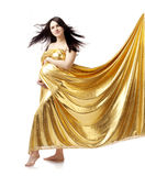 Beautiful cute pregnant girl in gold Stock Image