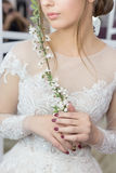 Beautiful cute tender young girl bride in wedding dress in mirrors with evening hair and gentle light make-up Stock Photography
