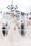 Beautiful cute tender young girl bride in wedding dress in mirrors with evening hair and gentle light make-up Royalty Free Stock Photography