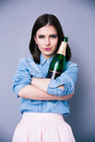 Beautiful cute woman holding bottle of champagne Stock Images