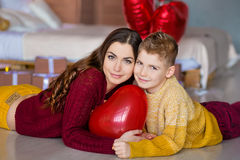Beautiful cute young brunette mom mother with her teenager handsome boy holding each other and happy together.Woman in Royalty Free Stock Image