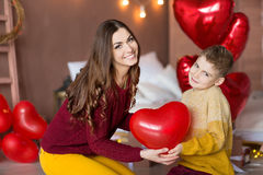 Beautiful cute young brunette mom mother with her teenager handsome boy holding each other and happy together.Woman in Royalty Free Stock Photography