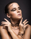 Beautiful cyber girl with black makeup Stock Photography