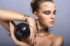Beautiful cyber girl with black  prickly ball Royalty Free Stock Images