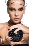 Beautiful cyber girl with black  prickly ball isolated on white Stock Photo