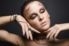 Beautiful cyber girl with linear black makeup Stock Photos