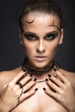 Beautiful cyber girl with linear black makeup Stock Image