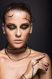 Beautiful cyber girl with linear black makeup Stock Images