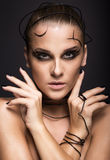 Beautiful cyber girl with linear black makeup Stock Photo