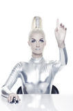 Beautiful cyber woman. Pointing at something royalty free stock photo