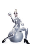 Beautiful cyber woman. Sitting on a silver ball royalty free stock image