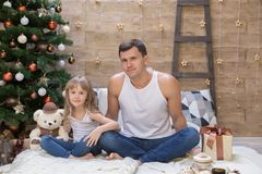 Dad and daughter, white t-shirt, blue jeans, gift box. Beautiful dad and daughter, has happy fun smiling face, dressed in white t-shirt, blue jeans, hold Royalty Free Stock Photography