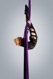 Beautiful dancer on aerial silk, aerial contortion, aerial ribbons, aerial silks, aerial tissues, fabric, ribbon. Tissue Stock Photography