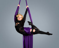 Beautiful dancer on aerial silk, aerial contortion, aerial ribbons, aerial silks, aerial tissues, fabric, ribbon Stock Photos
