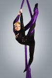 Beautiful dancer on aerial silk, aerial contortion, aerial ribbons, aerial silks, aerial tissues, fabric, ribbon. Tissue Stock Images