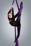 Beautiful dancer on aerial silk, aerial contortion, aerial ribbons, aerial silks, aerial tissues, fabric, ribbon Stock Images