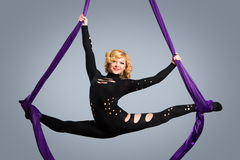 Beautiful dancer on aerial silk, aerial contortion, aerial ribbons, aerial silks, aerial tissues, fabric, ribbon. Tissue Royalty Free Stock Images