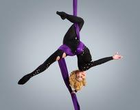 Beautiful dancer on aerial silk, aerial contortion, aerial ribbons, aerial silks, aerial tissues, fabric, ribbon. Tissue Royalty Free Stock Photos