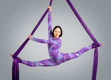 Beautiful dancer on aerial silk, aerial contortion, aerial ribbons, aerial silks, aerial tissues, fabric Royalty Free Stock Photography