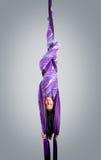 Beautiful dancer on aerial silk, aerial contortion, aerial ribbons, aerial silks, aerial tissues, fabric. Ribbon, tissue Royalty Free Stock Photos