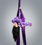 Beautiful dancer on aerial silk, aerial contortion, aerial ribbons, aerial silks, aerial tissues, fabric Royalty Free Stock Images