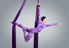 Beautiful dancer on aerial silk, aerial contortion, aerial ribbons, aerial silks, aerial tissues, fabric Stock Photo