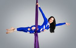 Beautiful dancer on aerial silk, aerial contortion, aerial ribbons, aerial silks, aerial tissues, fabric Stock Photography