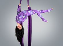 Beautiful dancer on aerial silk, aerial contortion, aerial ribbons, aerial silks, aerial tissues, fabric Stock Images
