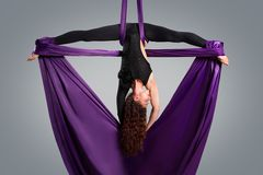 Beautiful dancer on aerial silk, aerial contortion Royalty Free Stock Photography