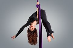 Beautiful dancer on aerial silk, aerial contortion Stock Photo