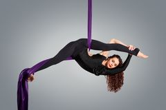 Beautiful dancer on aerial silk, aerial contortion Royalty Free Stock Photos