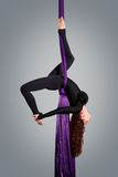 Beautiful dancer on aerial silk, aerial contortion Royalty Free Stock Image